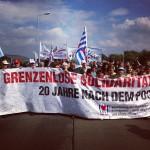 Fronttransparent auf der Demonstration anlässlich des 20. Jahrestages (Quelle: flickr.com/photos/30669460@N06/)
